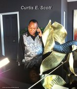 CURTIS E. SCOTT