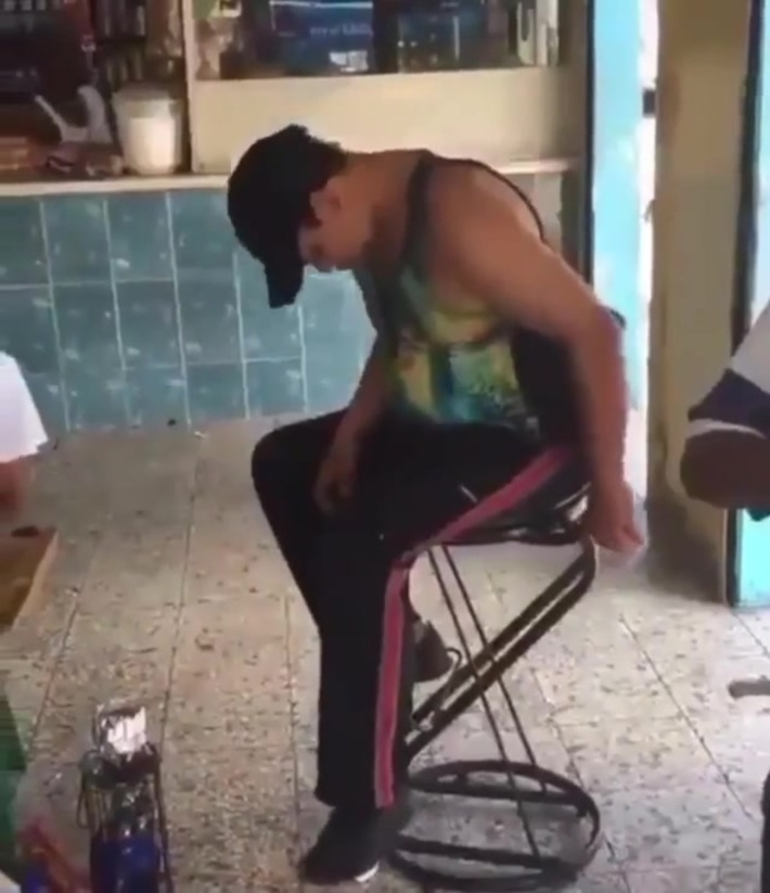 Drunk man falls off a stool