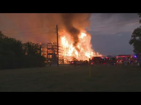 Firefighters respond to massive fire at apartment construction site in Katy area