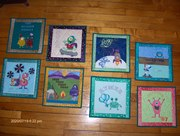Wall grouping of Mini Monster Quilts