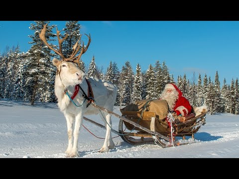 Christmas departure of Santa Claus: reindeer ride in Lapland Finland of Father Christmas