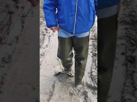 walking in waders in mud