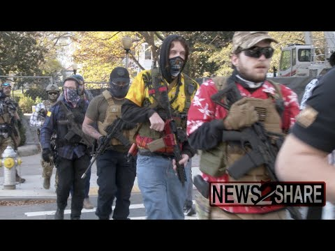 Militia activists march armed through Richmond, VA, where guns at protests are illegal