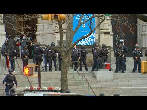 Man killed after opening fire on police outside St. John the Divine