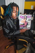 Jhonny Muslane with a copy of Maelle Ink Magazine