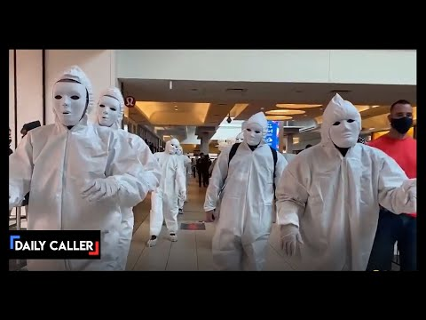 All White Masked Vaccine Protesters March Into Toronto Mall