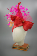 red beret with big bow and feathers