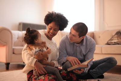 picture of biracial couple playing with baby girl