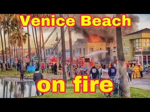 Homeless encampment fire burns down a two story building