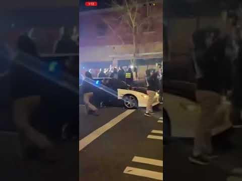 Shocking! Tacoma police officer plows through people blocking road