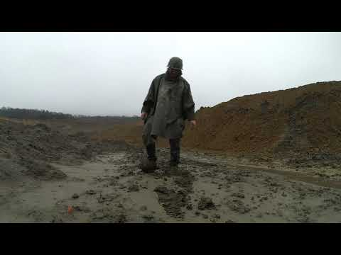 Mudbattle-field. Soldier in the rainy clay quarry.