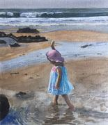 Child paddling at the beach
