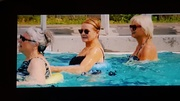 in the pool in I care a Lot