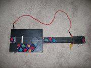 A cigar box mandolin called Henietta.