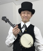 With a S.S.Stewart piccolo 'Little Wonder' banjo