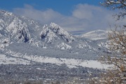 Boulder and the Flatirons with fresh snow after storm