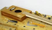 - 3 string acoustic cigar box guitar -