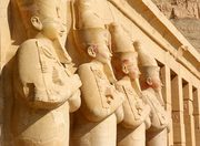 Hatshepsut's Osired statues from the upper terrace of her temple on The West Bank of Luxor