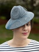 portrait with ocean-motif beaded hat