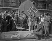 Crowd inspecting downed German aircraft in Wood Green, WWII