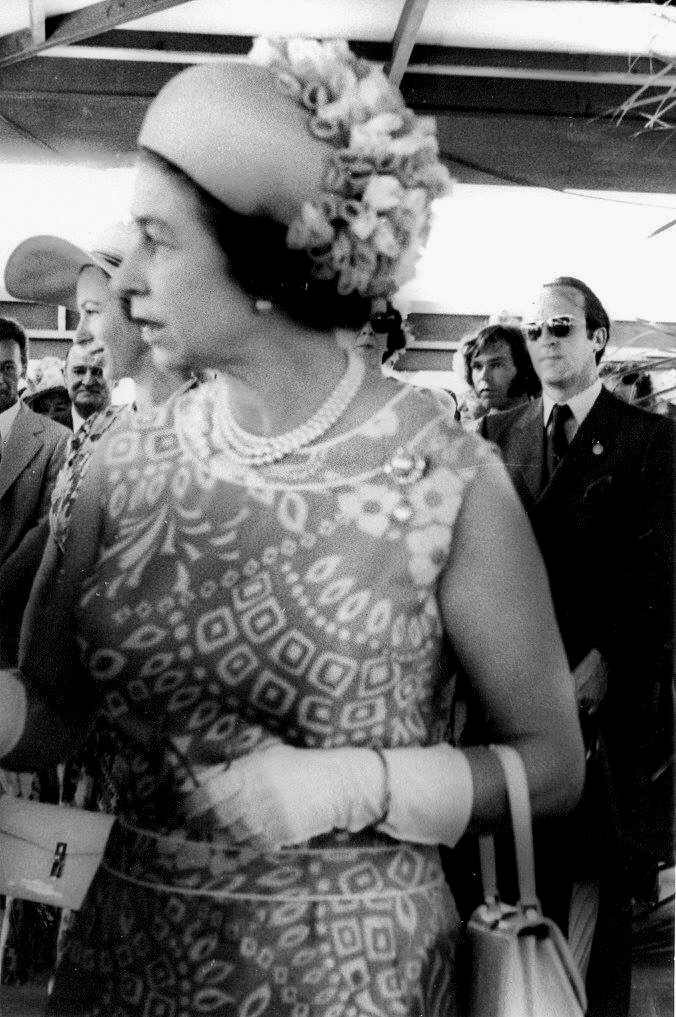 Her Majesty Queen Elizabeth II at the Opening of the Rarotonga International Airport with Princess Anne just off the Queen's shoulder and in the background is Bill Johnson just behind Her Majesty's Pv