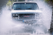 """1990 GMC Jimmy in the """"truck-shower"""" to get the underside clean"""