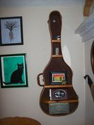 My fave old chipboard guitar case with cowboy and western print bit the dust last week at the age of 60 some years.  Now it is a pretty cool shelf in my music room.