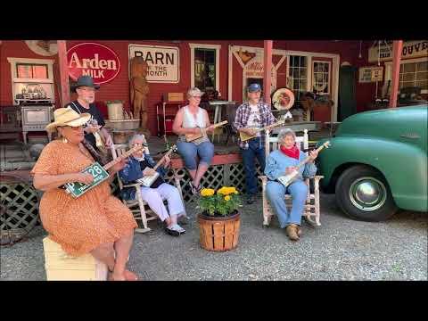 Singing in the Rain   Spokane Cigar Box Guitar Slingers
