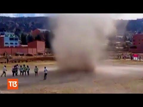 Dust Devil vs. Bolivian Soccer/Football Players