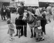 Children with Snap the Pit Pony at Harringay Arena, 1952