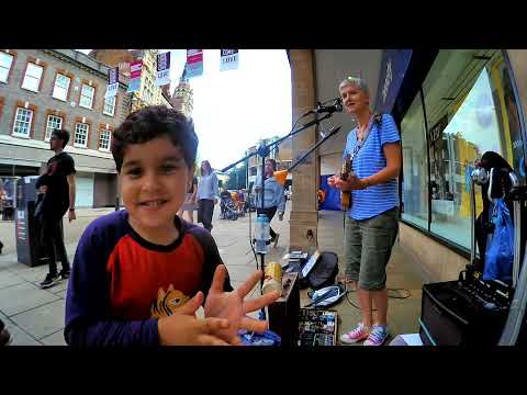Dancing boy -  busking  with 3 String Cigar Box Guitar and loop pedal
