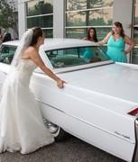 a girl, her Cadi and Bridesmaids