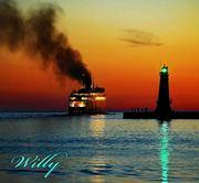 Ludington Mi. lighthouse and SS Badger