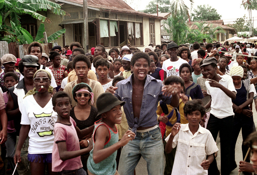 Dancing to music of Pan on the road - carnival-1975