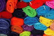 Cor em produtos têxteis e processos para sua obtenção